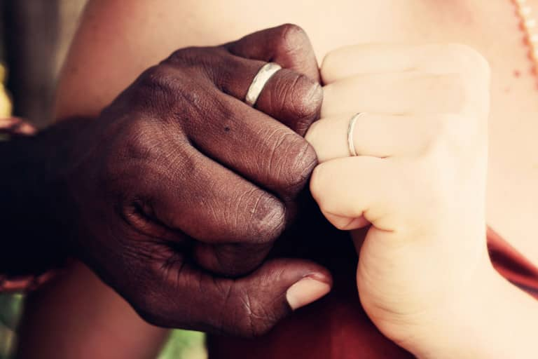 two people from different faiths hands